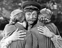 Embracing two of the girls after losing a comrade, Vaskov shows softness and empathy.