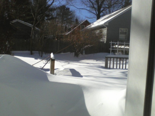 In Maine, the snow tends to pile up. The compost bin is out there. . .somewhere.