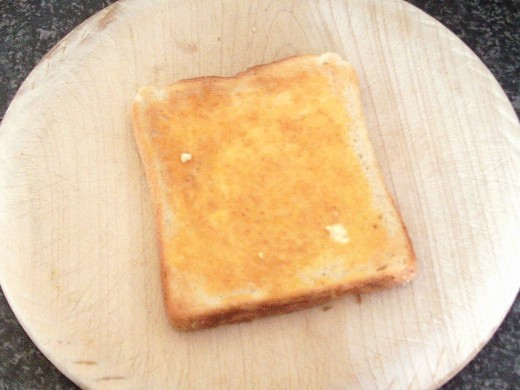 Hot toast is lightly buttered
