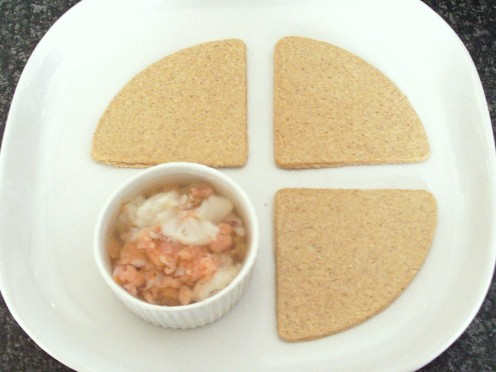 Jellied cod with smoked salmon and dill is served with traditional Scottish oatcakes
