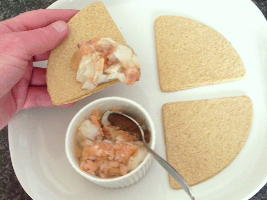 Jellied cod and smoked salmon is spooned on to an oatcake