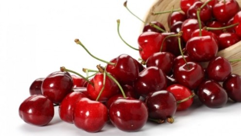 Picture of Cherries with article about 5 benefits of cherries that include fighting cancer, helps sleep, eases arthritis pain, keeps you trim & lowers high blood pressure.