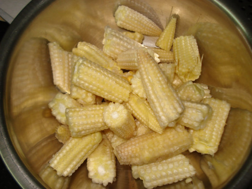 Cut some baby corn.