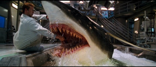 Stellan Skarsgard gets up, close and personal with a shark head - presumably the body was inserted in post-production
