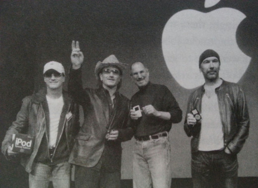 Jobs in 2004 with Bono and The Edge, the lead singer and guitarist of the Irish rock band U2. He attributed much of Apple's competitive advantages in developing the iPod to his personal passion for music.