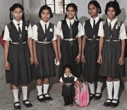 Jyoti's schoolfriends may tower over here but they look after her also