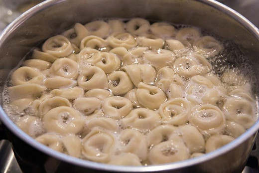 Cook tortellini in boiling water.