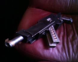 The captain's firearm, large hand cannon.