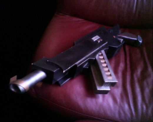 The captain's firearm, large hand cannon.