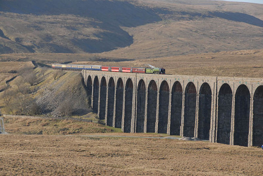 A1 Pacific 'Tornado' heads an up steam special over Ribblehead viaduct on a sunny afternoon