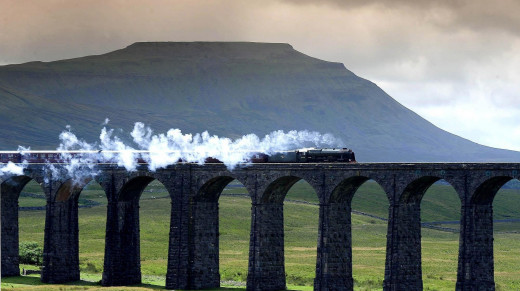 Ribblehead steam with Ingleborough behind. The locomotive is one of the preserved ex-LMS fleet