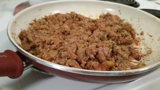 Add refried beans to the meat and veggie mixture. Make sure test and adjust your seasonings as you go.