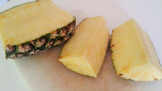 Quartered pineapples show their woody center, making it easy to chop it off.