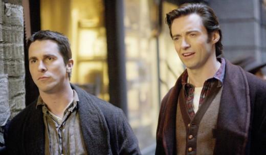 Christian Bale as Alfred Borden and Hugh Jackman as Robert Angier
