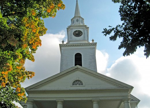 Beautiful fall foliage, a lovely sky and a New England church steeple.