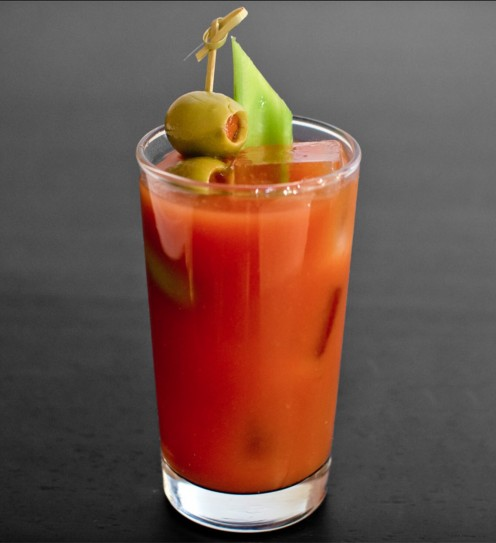 A spicy blend of Vodka, spices, tabasco sauce, and tomato juice, served on the rocks, with a celery and olives garnish.