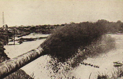 An oil gusher at Baku, on the Caspian Sea, spouting out oil at the rate of many tons every minute 24/7.  In the Baku oil fields much oil was wasted owing to crude methods of working during that time.