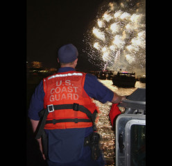 U.S. Coast Guard keeps a sharp eye on a fireworks display to make sure things go as planned.