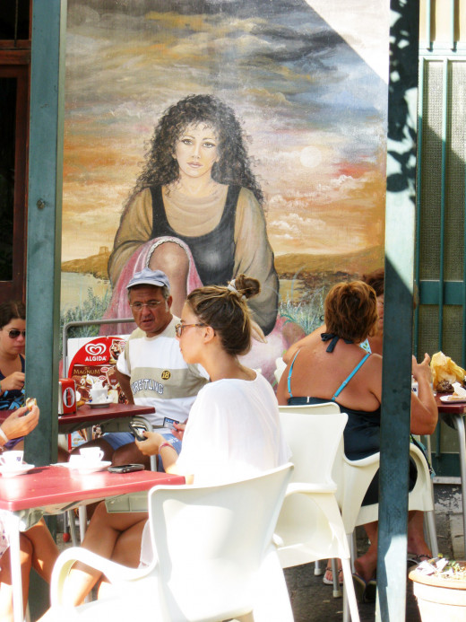 Colorful murals adorn the buildings in Ustica