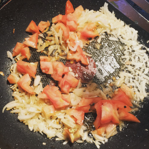 Stir frying onions and tomatoes