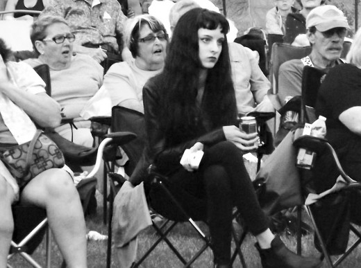 Me looking very enthused at a local concert. (does not speak to my love of music)