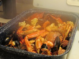 A delicious seafood combination of crab legs, shrimp, mussels, clams and corn on the cob was served.