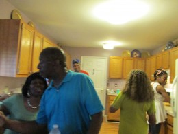 Uncles and aunts are busy in the kitchen preparing food for the shower.