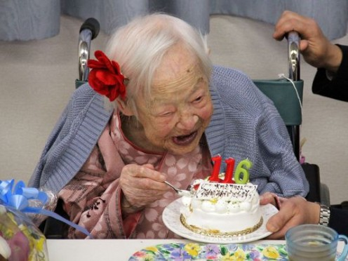 At onetime the world's oldest person, Misao Okawa, celebrates her 116th birthday at the nursing home in Osaka,  Japan.