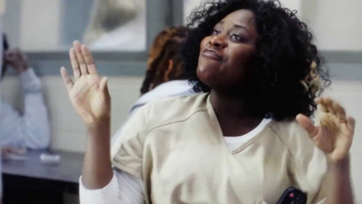 Taystee- actually was released from prison but did something purposely to get herself back in because she has no place to go on the 'outside.'  Best friend of Poussey.