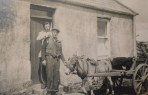 My granddad and his father Mac, stood outside the cottage with their donkey and cart. Photo from the 1940s.