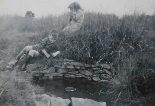 An aunt and uncle, drawing water from the well. Photo from the 1960s.