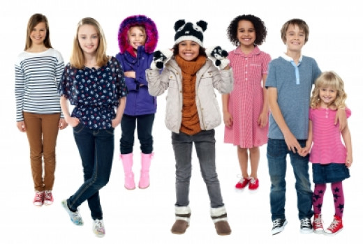 Group Of Children Standing Together - Image courtesy of stockimages at FreeDigitalPhotos.net
