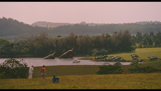 The first glimpse of a herd of Brachiosaurus roaming the landscape.