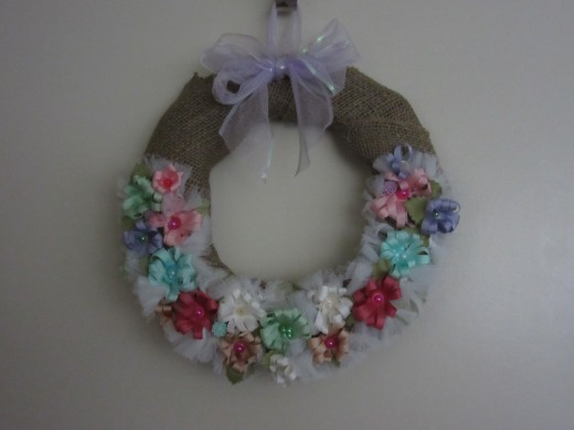 I created this ribbon rose wedding wreath with simple ribbon roses and burlap