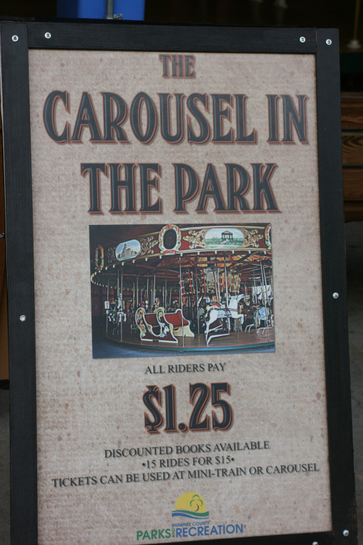Sign for the Carousel in the Park