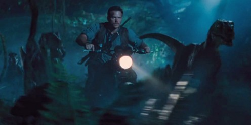 Park gamekeeper Owen Grady (Chris Pratt) scours the jungle alongside a pack of Velociraptors.