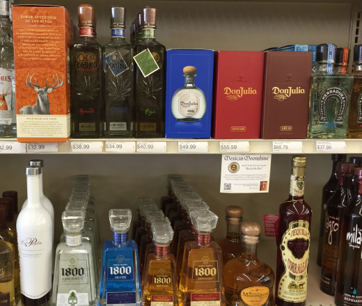 """Middle shelf"" tequilas, readily available with dozens of upper and lower shelf tequilas above and below, all awaiting your perusal in just about any liquor store north of the border."