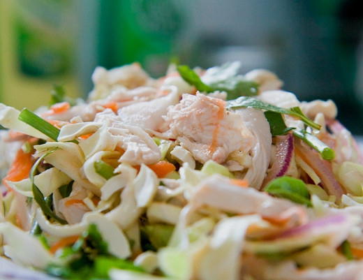 Seafood, chicken avocado and other ingredients can be added to a coleslaw.