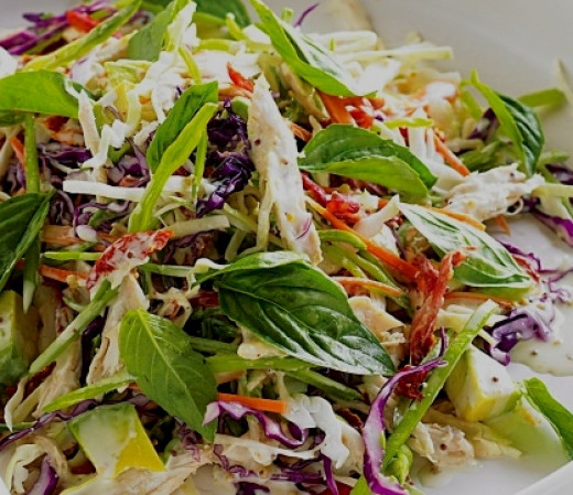Herbs, onions, carrots and other ingredients add depth, color and tastes to a standard coleslaw recipe.