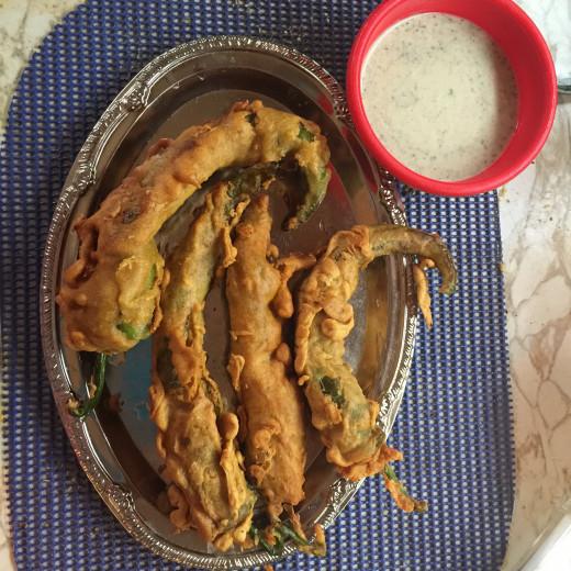 chilli pakoras ready ,served with chutney(Dip).