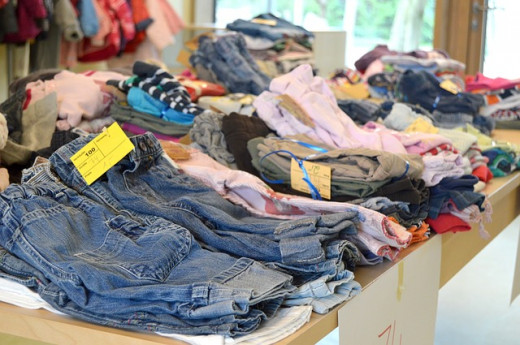 One ideal way to reduce clutter at home is to donate unwanted things, such as clothing at this flea market.