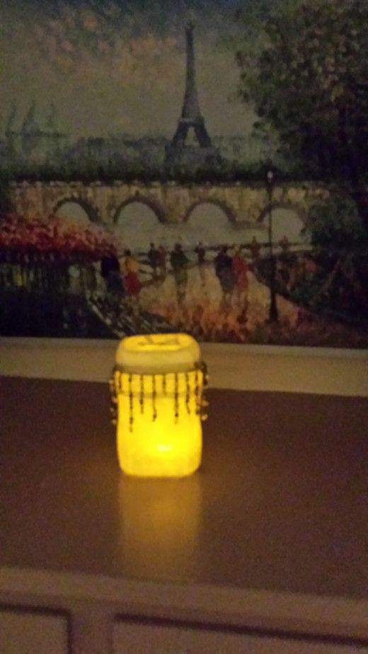 French's Onion container, with battery operated candle effect.