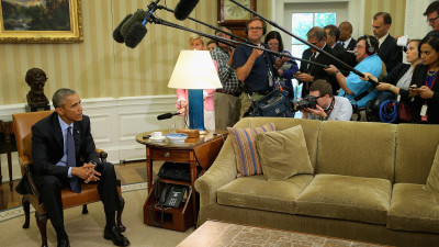 President Barack Obama talks to members of the news media in the Oval Office at the White House May 29, 2015, calling the USA FREEDOM Act an essential piece of legislation for fighting terrorism.