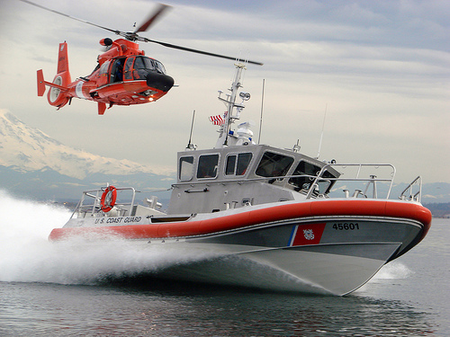 Coast Guard aircraft and rescue boat