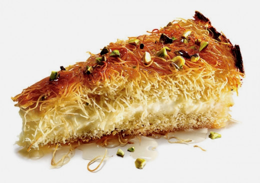 Pecans add a delightful touch to a Knafeh dessert imbibed with a sugar and rosewater syrup
