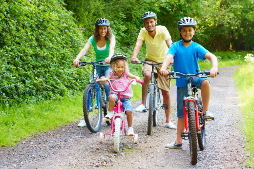 Family enjoying bike ride in the country