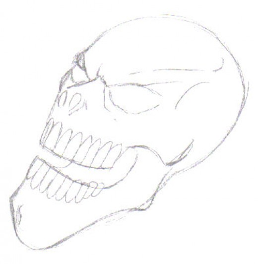 The whole of the skull design has been defined now by adding the teeth and a jaw line as well as the nose holes and the eyes.