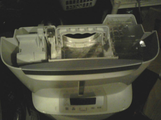 The dehumidifer water-catcher has a handy handle, and I dump the clean water right into the tub where I do our laundry pioneer-style: http://mgseltzer.hubpages.com/hub/I-Never-Replaced-Our-Washing-Machine-Part-One