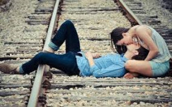 What an ignorant man. Laying on a railroad track to show his macho attitude to get the girl to kiss him.
