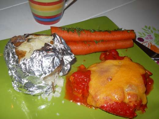 All three dishes -- the pizza pork chops, the baked potatoes, and the parsley carrots -- bake in the oven at the same time and temperature.